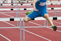 Single hurdle runner Royalty Free Stock Image