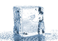 Single ice cube with water drops Stock Photos