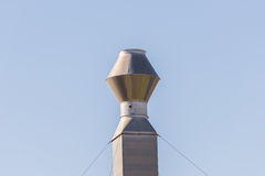 Single industrial chimney, metal smokestack against clear sky Royalty Free Stock Photo