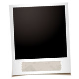 Single instant tape. Single instant photograph with old piece of masking tape Royalty Free Stock Photo