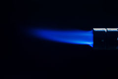 Single intense gas jet flame of industrial gas-burner Royalty Free Stock Photography