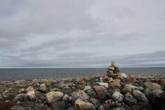 Single Inukshuk or Inuksuk along the arctic coast near Arviat. Nunavut Stock Image