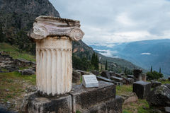 Single ionic order capital, Delphi, Greece Royalty Free Stock Images