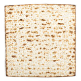 Single isolated Matza. Pesach jewish traditional textured Matza bread substitute isolated on white background Royalty Free Stock Photo
