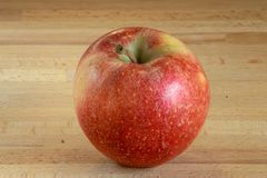 Single  red apple on a wooden board stock images