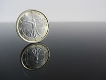 Single Italian Euro coins on grey background Stock Photos