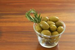 Single jar of green olives with rosemary Royalty Free Stock Image