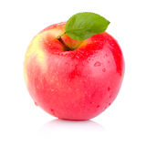 Single juicy Red apple with leaves stock images