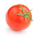 Single Juicy tomato with drops  on white Royalty Free Stock Photography