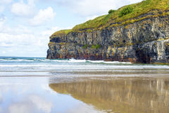 Single kayaker near the cliffs of ballybunion. Lone kayaker near the cliffs of ballybunion beach on the wild atlantic way ireland Stock Photo