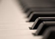 Single Key. Close up of piano keyboard with one key in focus Royalty Free Stock Photography