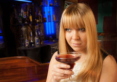 Single lady drinking alone in the club Royalty Free Stock Images