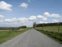 Single lane country road. Through countryside and farmland Royalty Free Stock Photography