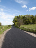 Single lane country road. Through countryside and farmland Royalty Free Stock Photos