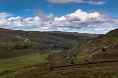 Single lane road B869 meanders through Assynt Peninsula, Scotlan Stock Image