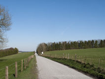 Single lane road. Through countryside and farmland Royalty Free Stock Images