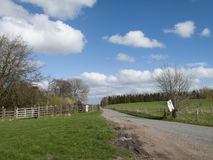 Single lane road. Through English countryside and farmland Stock Photography