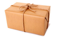 Single large brown paper parcel or package tied with thick rope isolated Stock Photo