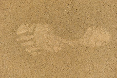 Single left footprint in sand with bubbles Stock Images