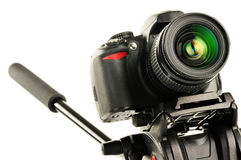 Single-lens reflex camera on tripod isolated on white Royalty Free Stock Photography