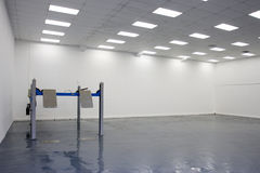 A single lift in car service garage. With a blue floor ( equipment for diagnostics of car stock photo