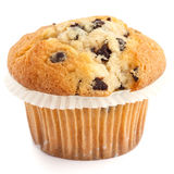 Single light chocolate chip muffin in wax liner on white Stock Photo