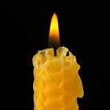 Single lighted candle. On black background Stock Image
