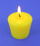 A single lit citronella candle Stock Image