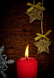 Single lit red Christmas candle. Royalty Free Stock Photos