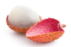 Single litchi with skin removed and flesh. On white Stock Photo