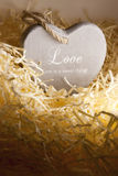 Single lone wooden heart in a love nest Stock Photo