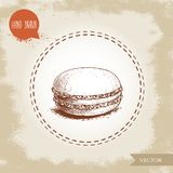 Single macaron cookie on vintage old background. Delicious french pastry sweet. Royalty Free Stock Photo