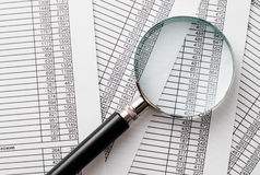 Single Magnifying Glass on Top of Business Reports Royalty Free Stock Image