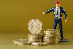 Single Male Model Points at British Pound coins Royalty Free Stock Images