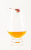 Single malt tasting glass with scorpion, single malt whisky in a Royalty Free Stock Photography