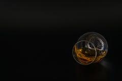 Single malt tasting glass, single malt whisky in a glass, black. Background, tasty set Royalty Free Stock Photo