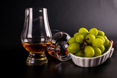 Single malt tasting glasses, single malt whisky in a glass, whit Royalty Free Stock Photography