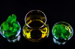 Single malt whiskey in a glass and green mint liqueur, refreshin. G set of drinks, taste sensations Stock Images