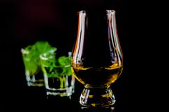 Single malt whiskey in a glass and green mint liqueur, refreshin. G set of drinks, taste sensations Stock Photo