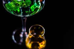 Single malt whiskey in a glass and green mint liqueur, refreshin. G set of drinks, taste sensations Stock Photography