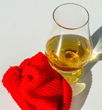 Single Malt Whiskey in a glass with a red cap, luxury tasting gl Stock Photo