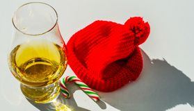 Single Malt Whiskey in a glass with a red cap, luxury tasting gl Royalty Free Stock Image