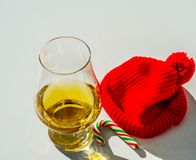 Single Malt Whiskey in a glass with a red cap, luxury tasting gl Royalty Free Stock Photo