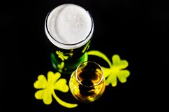 Single malt whiskey in a glass of tasting with decoration for St. Patrick`s day, green clover symbol for Irish holiday, festive Royalty Free Stock Images
