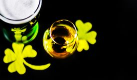 Single malt whiskey in a glass of tasting with decoration for St. Patrick`s day, green clover symbol for Irish holiday, festive Stock Photo