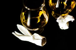Single malt whiskey in a glass of tasting with napkin bunny, fes. Tive Easter decoration, holiday Stock Images