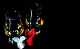 Single malt whiskey in a glass of tasting with napkin bunny, fes. Tive Easter decoration, holiday Stock Image