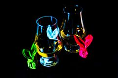 Single malt whiskey in a glass of tasting with napkin bunny, fes. Tive Easter decoration, holiday Stock Photography