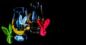 Single malt whiskey in a glass of tasting with napkin bunny, fes. Tive Easter decoration, holiday Royalty Free Stock Images
