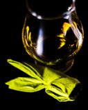 Single malt whiskey in a glass of tasting with napkin bunny, fes. Tive Easter decoration, holiday Royalty Free Stock Image